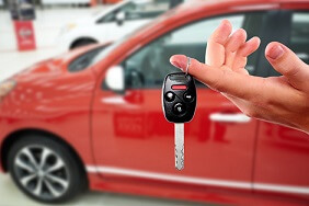 Car dealer holding car keys