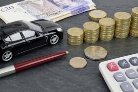 Toy car next to British money