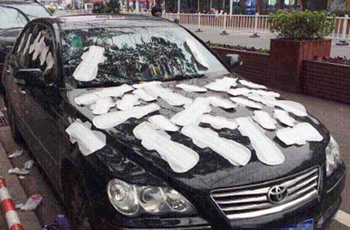 Car covered in sanitary napkins