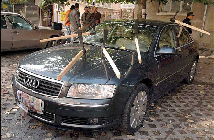 Car covered in pickaxes