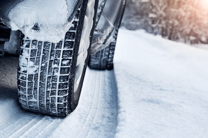 Winter tyres on a snowy road
