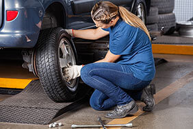 Mechanic servicing a car