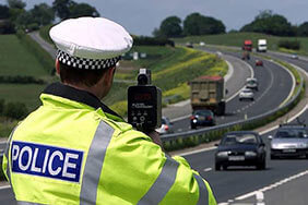 Police officer with speed gun