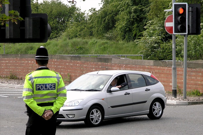 Policeman watches traffic