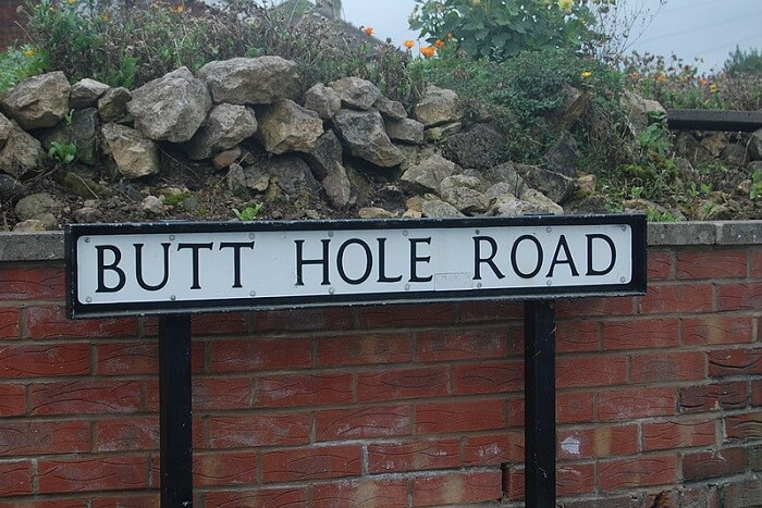 butt hole road sign