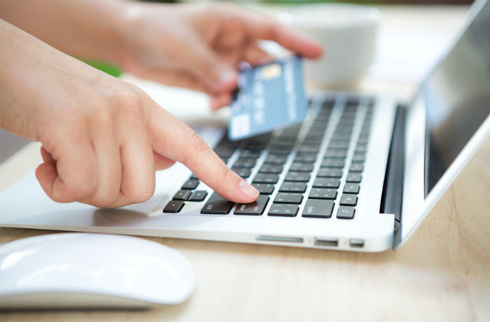 Woman using a credit card online