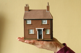 House held in human hands