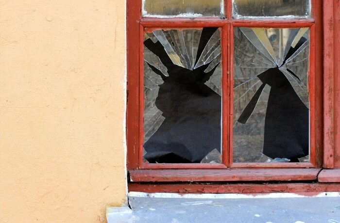 A house with a smashed window