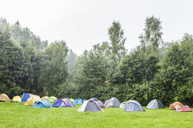 Tents in the rain at a festival